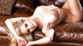 Inexperienced natural blonde debauched lusciuos cutie is adjustable her thoroughly stripped corpus on the leather ottoman
