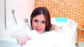 Horny kitty in the tub about to play with her wet body